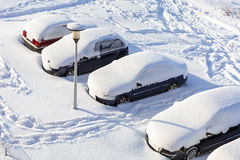 Snowy street with cars after winter snowfall Royalty Free Stock Photo