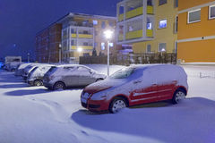 Snowy street with cars after winter snowfall Royalty Free Stock Photography