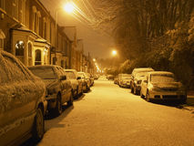Snowy street at night stock image
