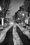 Snowy street at night Stock Photo