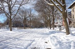 Snowy Street and Park in St. Paul. St. Paul, Minnesota, USA – JANUARY 23, 2018: Snowy city streets of Saint Paul along Portland Avenue and Nathan Hale Park in Royalty Free Stock Photography