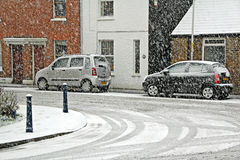 Snowy street scene parked cars Stock Photography