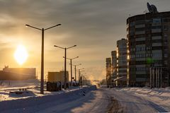 Snowy street on a sunny day. Norilsk Oganer. Snowy street on a sunny day. February 24, 2019. Norilsk Oganer royalty free stock images