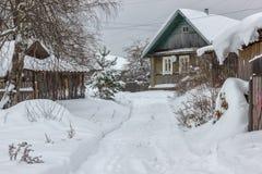 Snowy street in winter village. Early winter this year in the vi. Early winter this year in the village Royalty Free Stock Image