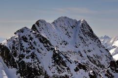 Snowy summit. Snow-covered Swinica peak in Polish Tatra mountains stock photography