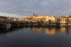 Snowy Prague Lesser Town with gothic Castle above River Vltava, Czech republic Royalty Free Stock Images