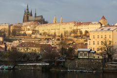 Snowy Prague Lesser Town with gothic Castle above River Vltava, Czech republic Stock Image
