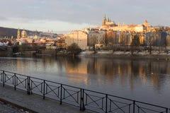 Snowy Prague Lesser Town with gothic Castle above River Vltava, Czech republic Stock Photo