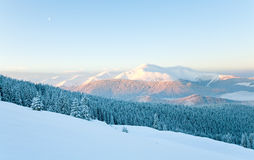 Snowy sunrise mountain landscape Stock Photos