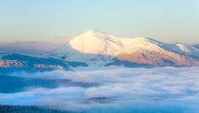 Snowy sunrise mountain  landscape Royalty Free Stock Photography