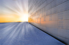 Snowy sunset. Fragment of the National Oslo Opera House in the rays of the setting sun Stock Image