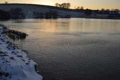 Snowy Sunset at Waldegrave Pool & North Hill. Priddy Mineries, Mendip Hills, Somerset stock photo