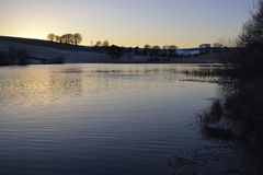Snowy Sunset at Waldegrave Pool & North Hill. Priddy Mineries, Mendip Hills, Somerset royalty free stock photography