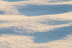 Snowy surface background in sunrise light Royalty Free Stock Photos