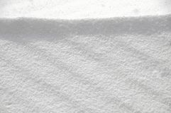 Snowy surface texture in sunny weather. In winter stock photo