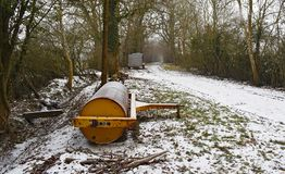 On a snowy Sussex lane. A view along a snow covered rural lane with farm equipment by the side of the lane Stock Images