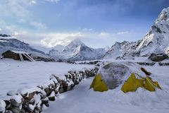 Snowy tent in mountains Royalty Free Stock Image