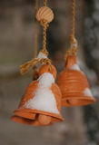 Snowy Terracotta Bells Stock Photos