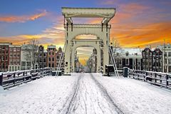 Snowy tiny bridge in Amsterdam the Netherlands in winter stock image