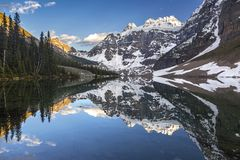 Consolation Lakes Banff National Park. Snowy Top of Mountain Quadra reflected in calm water of Consolation Lakes in Banff National Park Rocky Mountains Alberta royalty free stock photography