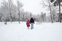 Snowy town park. Mother and daughter walking the snowy town park Stock Images