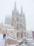 Snowy towns Cathedral, Spain. View of the cathedral of Burgos Spain in winter and snowing Royalty Free Stock Photo