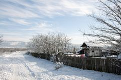 Snowy trace near household Royalty Free Stock Images