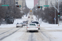 Snowy traffic. Cars and trucks climbing a steep hill covered in snow and ice Stock Images