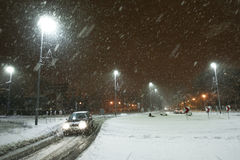 Snowy traffic at night. Cars driving on the road in the aggravated traffic due to strong snowfall Stock Photography
