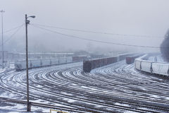 Snowy Train Yard. Train tracks covered with snow during a winter storm stock images