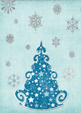 Snowy tree card template. Pale blue snowy scene.  Features seasonal Christmas Tree, snow flakes and glitter design.  Suitable for background or to make your own Stock Images