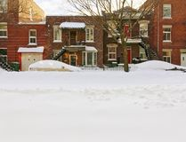 Snowy urban street with brick buildings. Space for text. Montreal, Quebec, Canada Royalty Free Stock Images