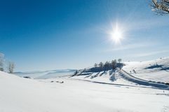 Snowy valley at the top of the mountain with a clear blue sky on a sunny day royalty free stock image