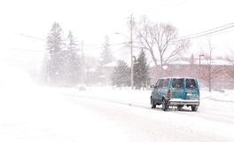 Snowy van. A van on a snow covered road Royalty Free Stock Photos