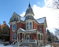 Snowy Victorian. Beautiful Victorian sprinkled with snow is the nicest house on the block Stock Photos