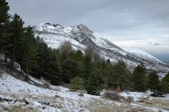 Snowy view of De Fiore volcanic crater born on 1974 in Etna Park. Sicily stock images