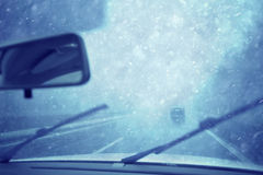 Snowy view through vehicle windshield on highway Stock Photography