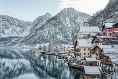 Free Snowy Village Hallstatt By Lake At Foot Of Snow Mountain With Clear Sky In Winter In Austria Royalty Free Stock Photo - 207447215