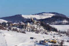 Snowy village on the hill Stock Photography