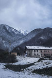 Snowy village in mountains Royalty Free Stock Photo