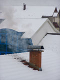Snowy village roofs Stock Photo