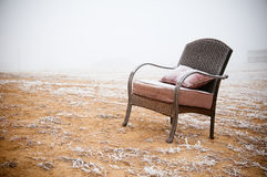 Snowy Vintage Chair. Vintage chair ona morning frost after a night of snow Royalty Free Stock Image