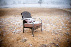 Snowy Vintage Chair. Vintage chair ona morning frost after a night of snow Royalty Free Stock Photography
