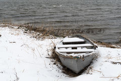 Snowy vintage rowing boat Stock Photos