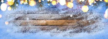 Snowy vintage wooden table Stock Image