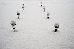 Snowy walkway lights Royalty Free Stock Photos