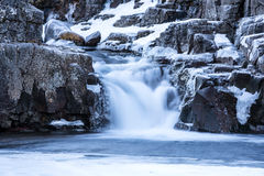 Snowy waterfall in Iceland`s highlands Royalty Free Stock Photography