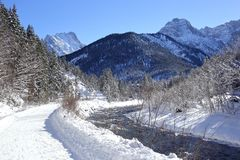 Snowy way near a river Stock Photography