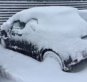 Snowy wheels. Car totally covered by thick layer of snow Royalty Free Stock Photography