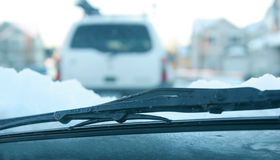 Snowy Windshield Wiper. And view of traffic through the windshield Royalty Free Stock Images